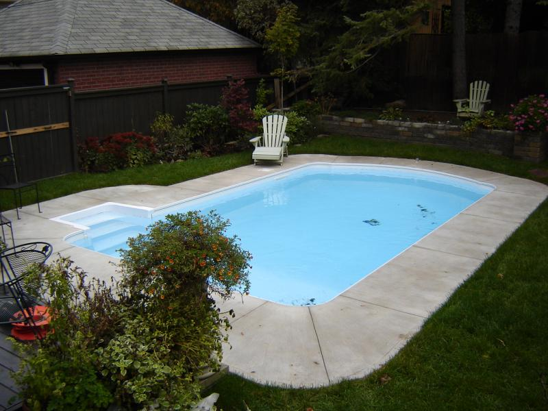 Cool pools ruby award winner art of water design awards this award winning pool features two - Witte pool liner ...